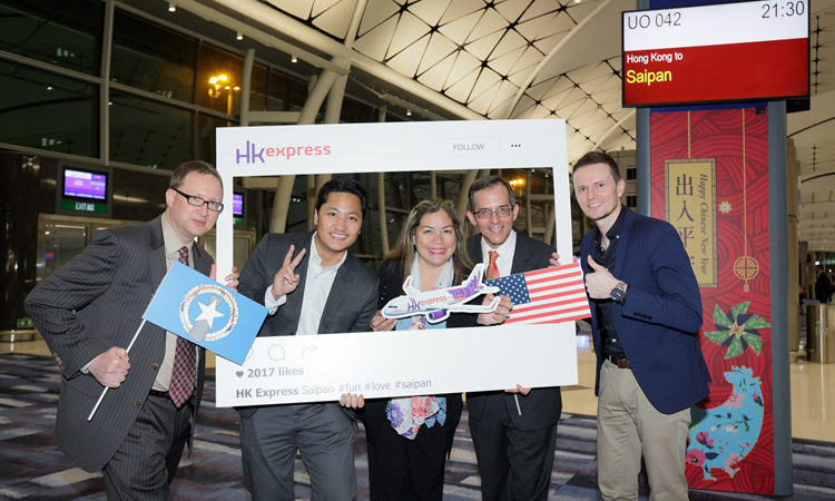Mr. Brian Bedell, Mr. Christopher Concepcion, Mr. Thomas Hodges with HK Express passengers and staff (State Dept.)