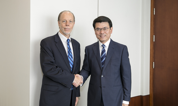 Acting Assistant United States Trade Representative for China Affairs Terrence J. McCartin and Secretary for Commerce and Economic Development Edward Yau (State Dept.)