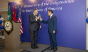 Consul General Tong toasted with Secretary Lionel Leong. (State Dept.)