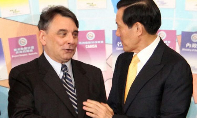 AIT Director William Stanton (left) and President Ying-Jeou Ma (right) at the 2010 International Combating Human Trafficking Workshop on September 1, 2010. (Photo Credits: AIT)