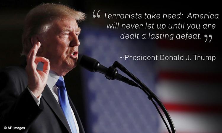 President Trump at podium saying 'Terrorists take heed ...' (© AP Images)