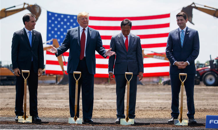 Eleven months after Foxconn announced plans for a $10 billion electronics plant in Wisconsin, President Trump led dignitaries at the June 28 groundbreaking ceremony. (© Evan Vucci/AP Images)