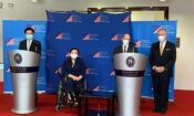 Senator Chris Coons giving remarks