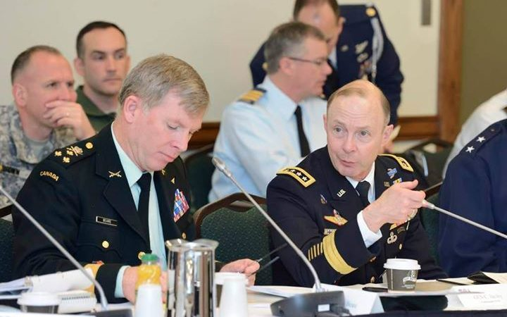 U.S. Army Gen. Charles Jacoby, Commander, NORAD and USNORTHCOM, and LGen Stuart Beare, Commander of Canadian Joint Operations Command, attend a plenary session at the 7th Annual Tri Command Staff Talks in Ottawa March 26, 2014.