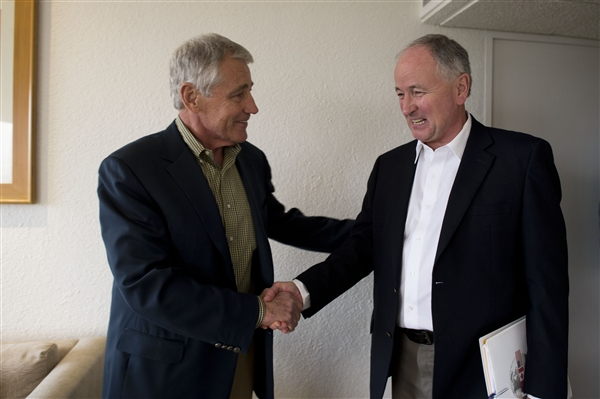 Defense Secretary Chuck Hagel, left, greets Canadian Defense Minister Robert Nicholson before meeting in Mexico City, April 23, 2014.