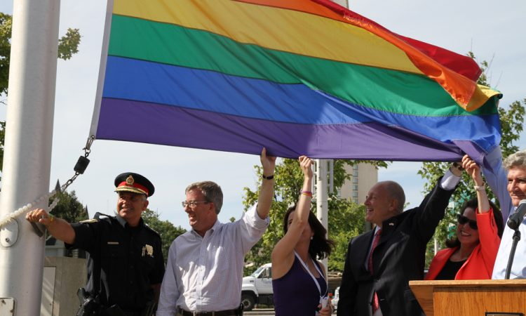 Ambassador Heyman helps raise the Pride Flag at Ottawa City Hall.