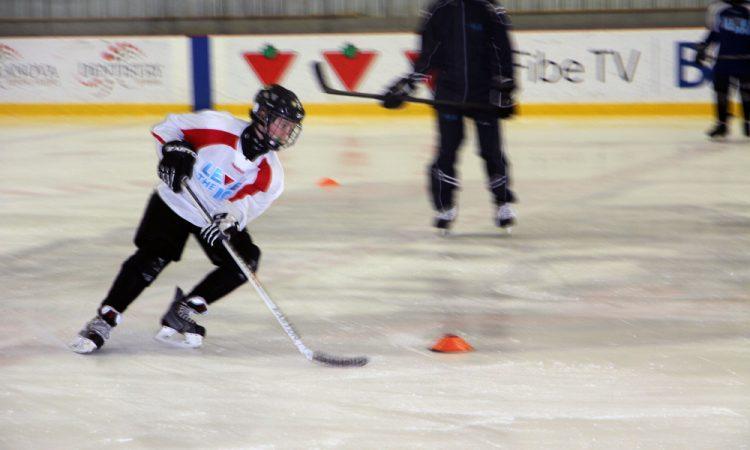 A young Ottawa hockey player goes through a drill as part of the Embassy-sponsored hockey camp Level The Ice.