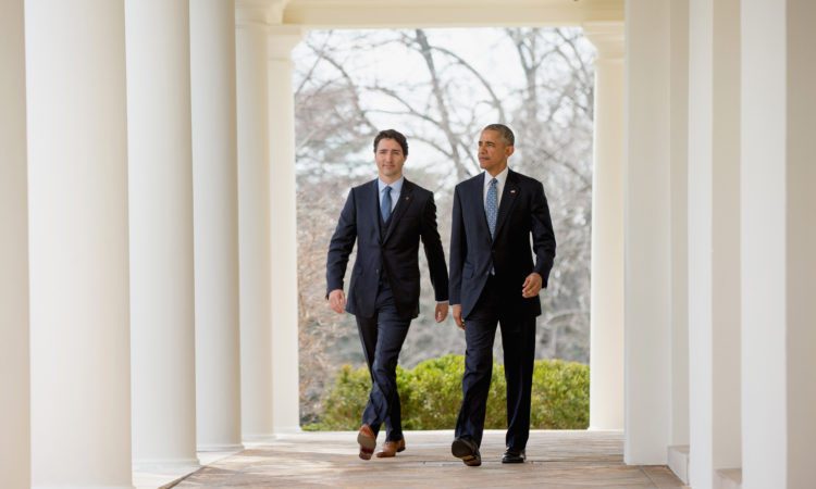 President Barack Obama and Canadian Prime Minister Justin Trudeau walks through the colonnade to speak at a bilateral news conference in the Rose Garden of the White House in Washington, Thursday, March 10, 2016. (AP Photo/Andrew Harnik)