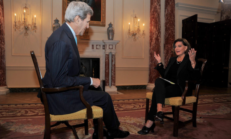 U.S. Secretary of State John Kerry sits with CTV Anchor Lisa LaFlamme on March 9, 2016, at the U.S. Department of State in Washington, D.C., before an interview in advance of the State Visit of Canadian Prime Minister Justin Trudeau. [State Department photo/ Public Domain]