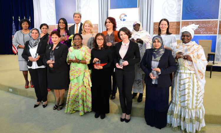U.S. Secretary of State John Kerry and U.S. Ambassador-at-Large for Global Women's Issues Cathy Russell pose for a photo with the 2016 Secretary of State's International Women of Courage Award winners at the U.S. Department of State in Washington, D.C., on March 29, 2016. [State Department photo/ Public Domain]