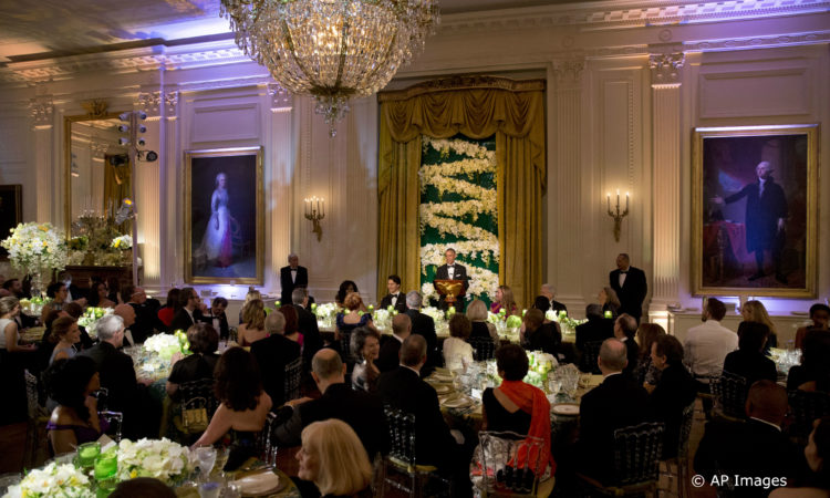 President Barack Obama toasts Canadian Prime Minister Justin Trudeau during a State Dinner in the East Room of the White House in Washington, Thursday, March 10, 2016. The head table included first lady Michelle Obama, Sophie Gregoire Trudeau, and actor Michael J. Fox. (AP Photo/Jacquelyn Martin)
