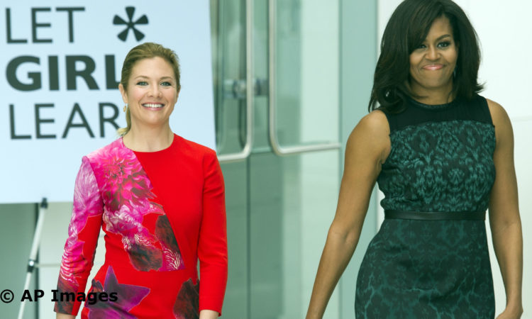 First lady Michelle Obama and Sophie Grégoire-Trudeau, wife of Canadian Prime Minister Justin Trudeau, walk to a stage to participate in a program at the U.S. Institute of Peace in Washington, Thursday, March 10, 2016, to highlight Let Girls Learn efforts and raise awareness for global girl's education. (AP Photo/Cliff Owen)