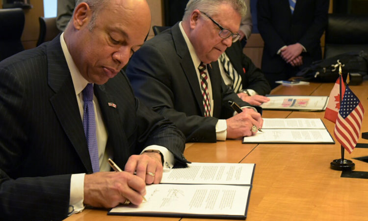United States Secretary of Homeland Security Jeh Johnson and the Honourable Ralph Goodale, Minister of Public Safety and Emergency Preparedness sign the Joint Statement of Intent regarding Preclearance on Thursday, March 10, 2016, in Washington, D.C. Credit Public Safety Canada.