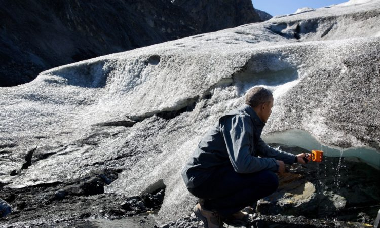 President Obama collecting melt runoff from the ice of Mendenhall Glacier (Official White House Photo by Pete Souza)