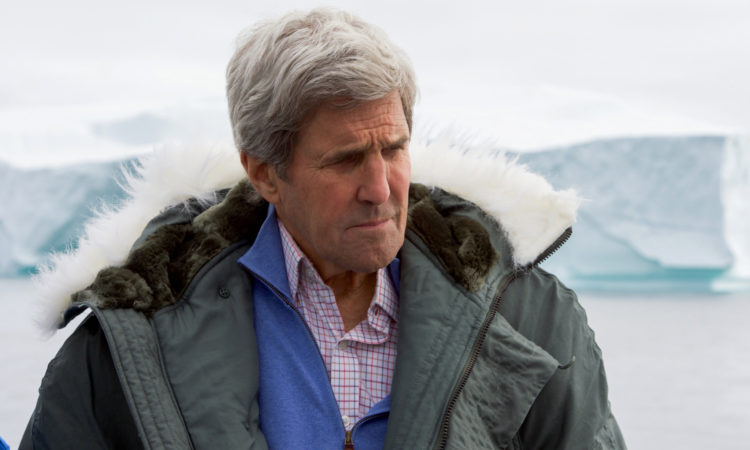 U.S. Secretary of State John Kerry listens as he receives a briefing from a group of climate change scientists on June 17, 2016, as they cruise aboard the HDMS Thetis in the waters off Ilulissat, Greenland, so he and Danish Foreign Minister Kristian Jensen could view an iceberg field created by the Jacobshavn Glacier Front, receive the science briefing, and meet with Greenlandic Premier Kim Kielsen and Foreign Minister Vittus Qujaukitsoq. [State Department photo/ Public Domain]