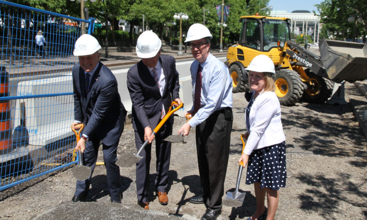 (From left) Ambassador Heyman, NCC CEO Mark Kristmanson, Mayor Jim Watson and MPP Madeleine Meilleur break ground on Ottawa's Mackenzie Avenue bike lane. Credit US Embassy Ottawa.