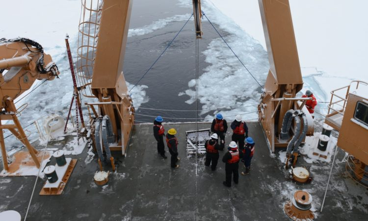 Crewmembers aboard Coast Guard Cutter Healy prepare to deploy a dredge in the Arctic Ocean on Sept. 23, 2016. The dredge collected rock samples from outcrops of a seafloor canyon. U.S. Coast Guard photo by Petty Officer 3rd Class Lauren Steenson.