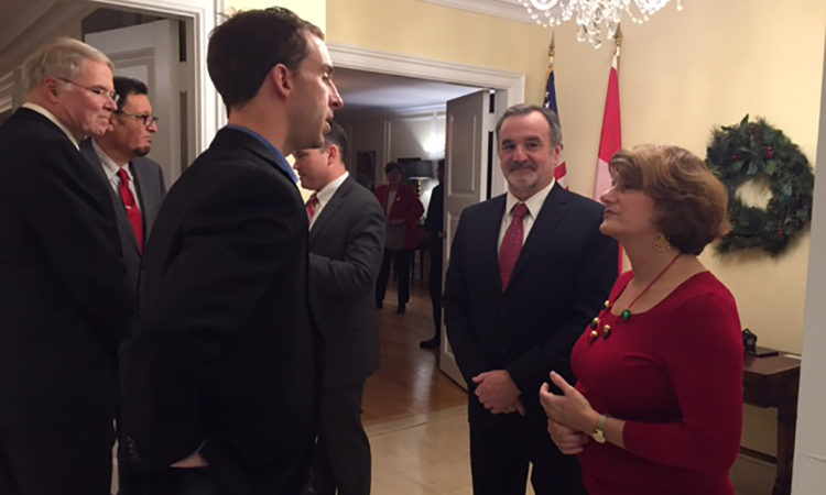 Quebec Consul General Allison Areias Vogel welcomes visitors to her holiday celebration. Credit US Consulate Quebec.