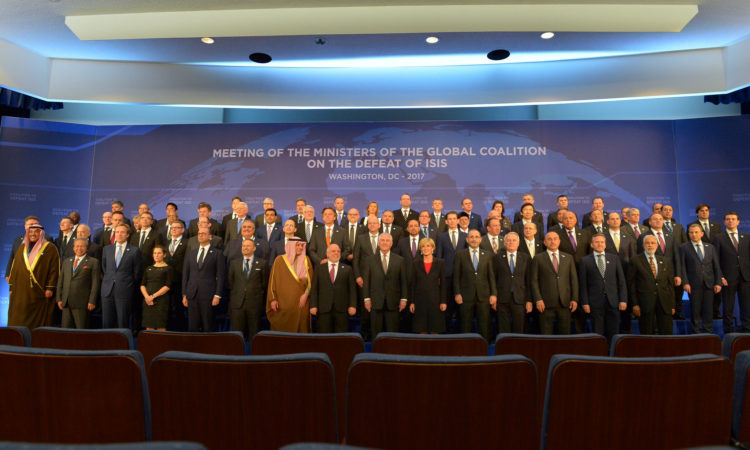 U.S. Secretary of State Rex Tillerson poses for a family photo with counterparts at the Meeting of the Ministers of the Global Coalition on the Defeat of ISIS in Washington, D.C. on March 22, 2017. [State Department Photo/ Public Domain]