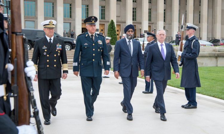 Defense Secretary Jim Mattis walks Canadian Defense Minister Harjit Sajjan, Mexican Defense Secretary Gen. Cienfuegos Zepedas and Mexico's secretary of navy, Adm. Vidal Soberón, at the the third North American Defense Ministerial meeting at the Pentagon.