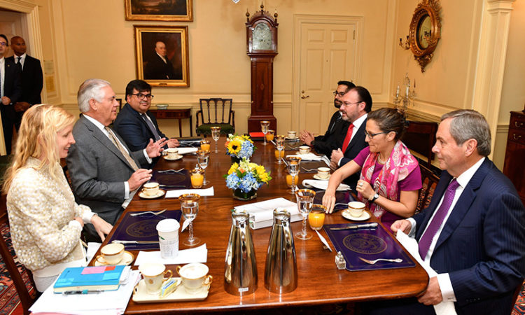 U.S. Secretary of State Rex Tillerson, with Chief of Staff Margaret Peterlin and Acting Assistant Secretary of State for Western Hemisphere Affairs Francisco Palmieri, hosts a working breakfast for Mexican Foreign Secretary Luis Videgaray Caso and Canadian Foreign Minister Chrystia Freeland at the U.S. Department of State in Washington, D.C., on May 31, 2017. Also pictured is Canadian Ambassador to the U.S. David MacNaughton. [State Department photo/ Public Domain]