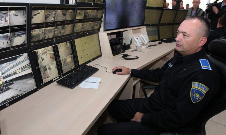 A police officer looking at a computer security