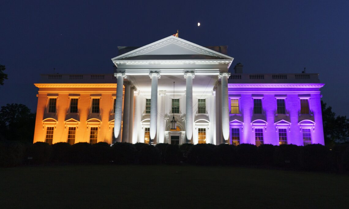 The White House is lit with purple and gold light to celebrate 100 years of the 19th Amendment and women's constitutional right to vote, Wednesday, Aug. 26, 2020, in Washington. (AP Photo/Alex Brandon)