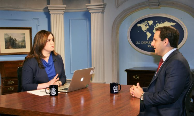 Acting Deputy Spokesperson Elizabeth Fitzsimmons moderates a Facebook Live discussion with U.S. Ambassador to the Organization of American States Carlos Trujillo on April, 20, 2018 ( U.S. Department of State)