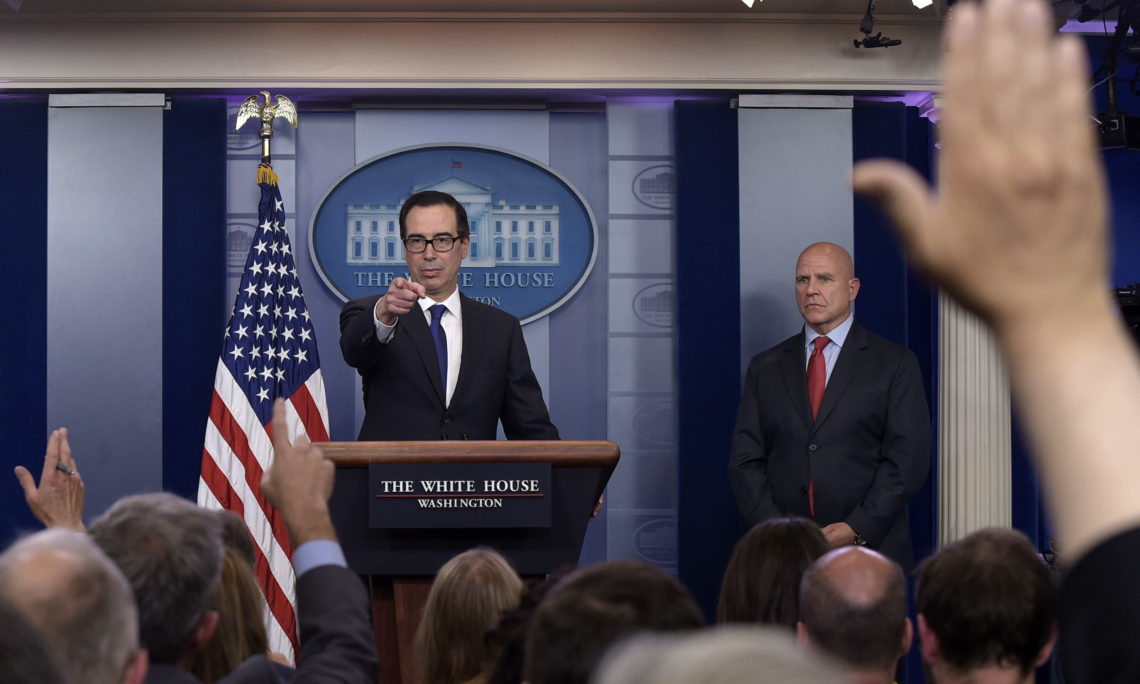 Treasury Secretary Steven Mnuchin, left, standing with National Security Advisor H.R. McMaster, right, calls on a reporter at the daily briefing at the White House in Washington, Monday, July 31, 2017, after announcing Venezuela sanctions. (AP Photo/Susan Walsh)