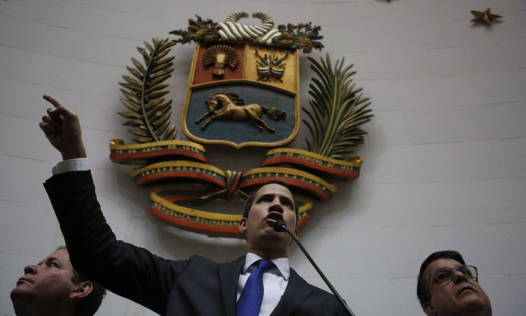 Interim President Juan Guaido speaks at the National Assembly in Caracas, Venezuela, Tuesday, Jan. 7, 2020. (AP Photo/Andrea Hernandez Briceño)