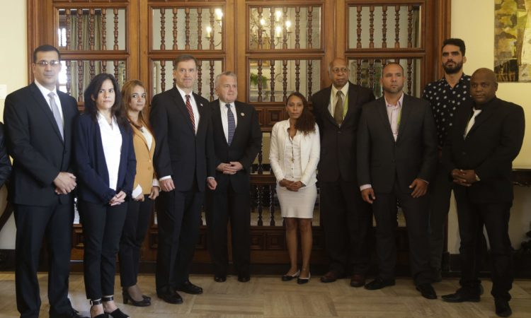 Acting Secretary of State John Sullivan, center, pose with Cuban civil society leaders at US Embassy home in Lima, Peru, Thursday, April 12, 2018. (AP Photo/Martin Mejia)