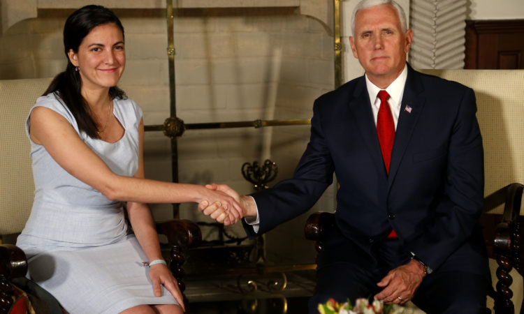 U.S. Vice President Mike Pence shakes hands with Rosa Maria Paya, daughter of the late Cuban dissident Oswaldo Paya, after a meeting at the residence of the U.S. ambassador, in Lima, Peru, Friday, April 13, 2018. (AP Photo/Karel Navarro)