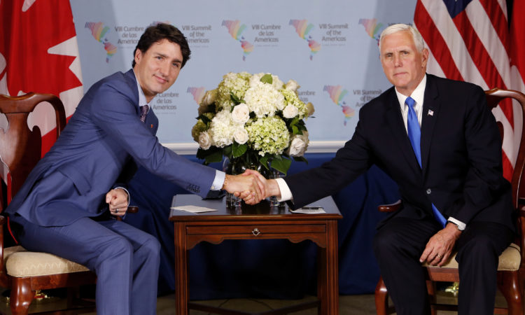 U.S. Vice President Mike Pence, right, shakes hands with Canada's Prime Minister Justin Trudeau after a bilateral meeting at the Summit of the Americas in Lima, Peru, Saturday, April 14, 2018. (AP Photo/Karel Navarro)