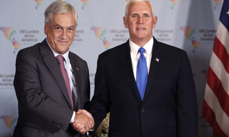 U.S. Vice President Mike Pence, right, shakes hands with Chile's President Sebastian Pinera during a bilateral meeting at the Summit of the Americas in Lima, Peru, Saturday, April 14, 2018. (AP Photo/Karel Navarro)