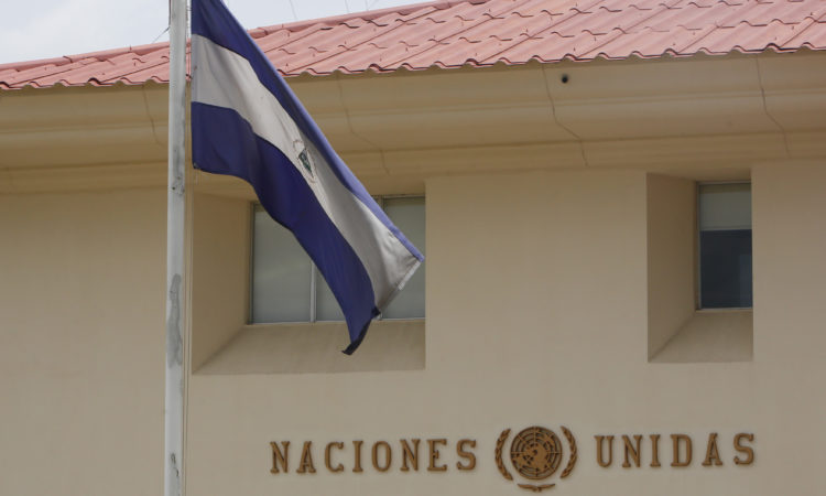 The Nicaraguan flag flies in front of the United Nation's building in Managua, Nicaragua, Friday, Aug. 31, 2018. Guillermo Fernandez Maldonado, chief of the United Nation's human rights mission in Nicaragua, said that he and his team would leave the country Saturday. The government of Nicaraguan President Daniel Ortega is expelling the U.N. team two days after the body published a critical report blaming it for the violent repression of opposition protests. (AP Photo/Alfredo Zuniga)