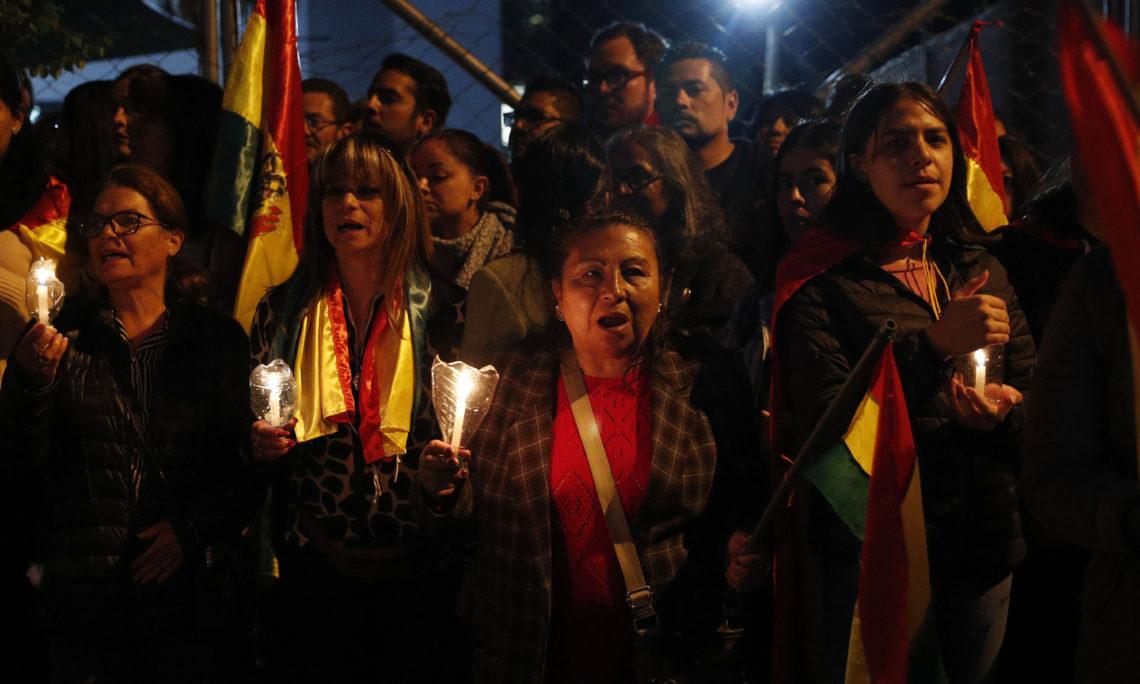 Demonstrators protest the government of President Evo Morales in La Paz, Bolivia, Sunday, Nov. 3, 2019. (AP Photo/Juan Karita)