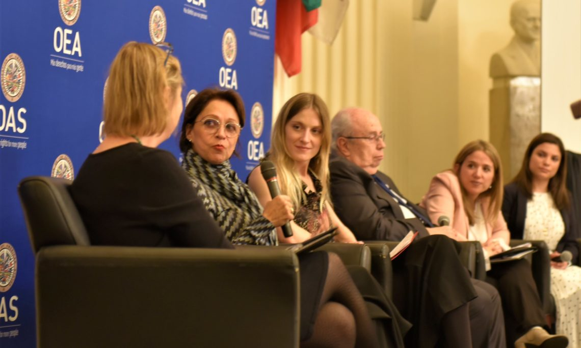U.S. Deputy Assistant Secretary of State for Western Hemisphere Affairs Carrie Filipetti (center) moderates a panel discussion alongside filmmaker and director Margarita Cardenas. (OAS Photo)