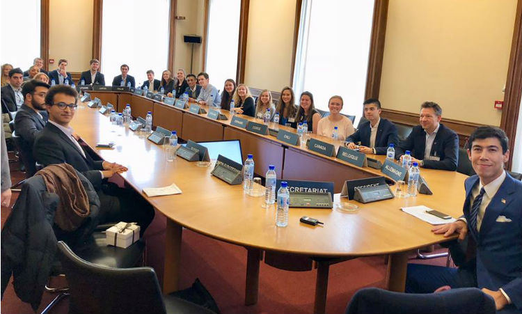 Group sitting at table. (Mission Image)