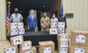 U.S. Chargé d'Affaires, a.i. Keith Gilges presented the food packs and hygiene kits to NEMO Director Shelton Defour