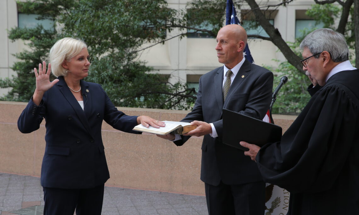 The Honorable Jennifer L. Homendy was sworn in as the National Transportation Safety Board's 15th Chair, Friday, by Alfonso Montaño, the NTSB's Chief Administrative Law Judge (right), during an outdoor ceremony at NTSB Headquarters. Board Member Michael Graham (center) held Homendy's family Bible for the ceremony. NTSB photo by James Anderson