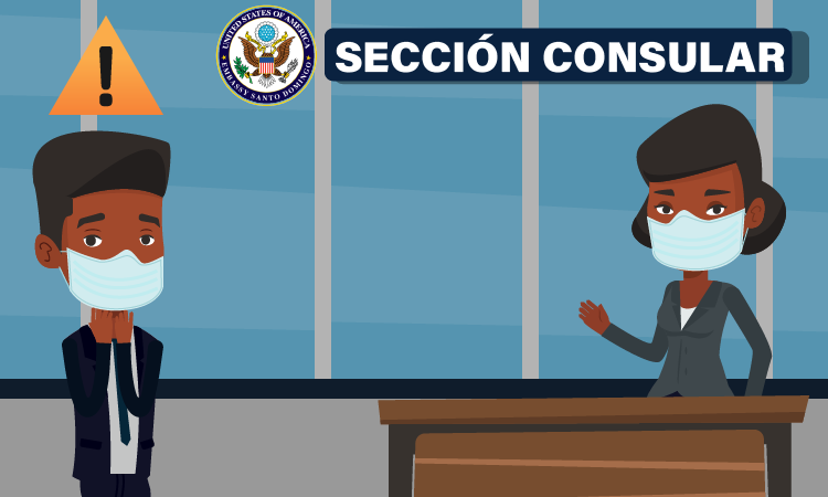 a standing man and woman behind a desk, socially distanced and masked.