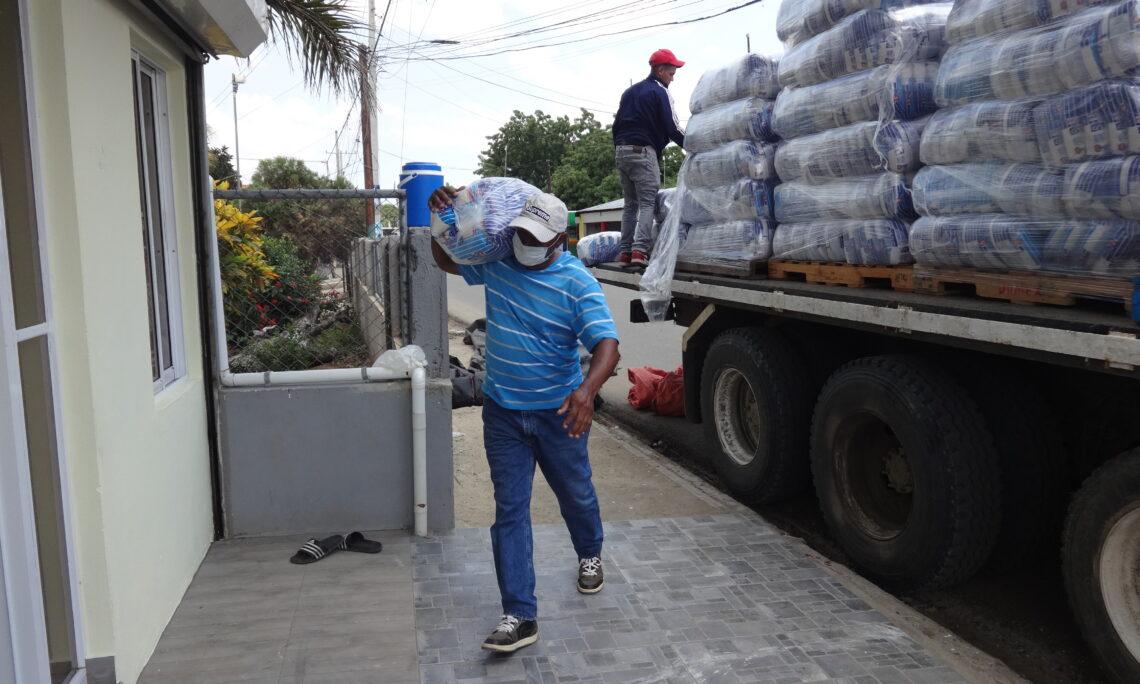 man walking distributing food
