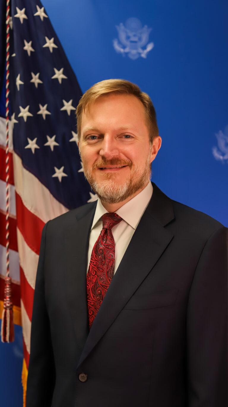 Photo of Chargé d'Affaires Robert W. Thomas