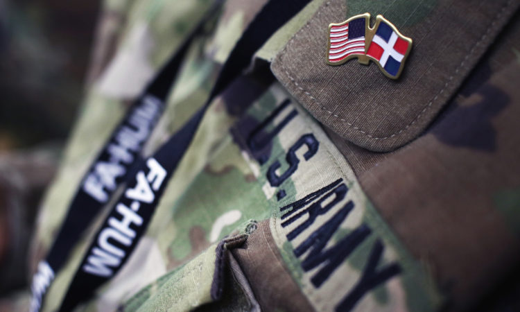 A U.S. Army Uniform, with a pin showing the Dominican and American flags, and an ID card string that reads FA-HUM