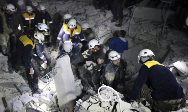 White Helmets-Photo from Syrian Civil Defense White Helmets via AP