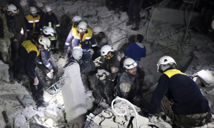White Helmets-Photo from Syrian Civil Defense White Helmets via AP
