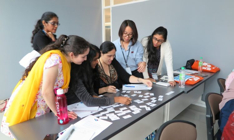 "Participants play a game called ""Activate Sentence Race"" during a workshop conducted by English Language Fellow Thai-Hoa Le. (U.S. Embassy photo)"