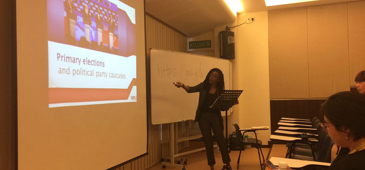 Public Affairs Intern Amanda Whatley explains primary elections to MCKL students. (U.S. Embassy photo)