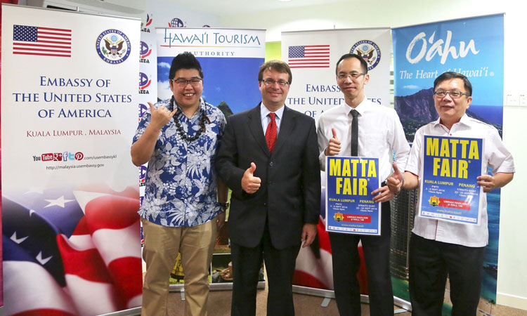 Deputy Chief of Mission Edgard Kagan (second from left) after the MATTA Fair press conference. (U.S. Embassy photo)