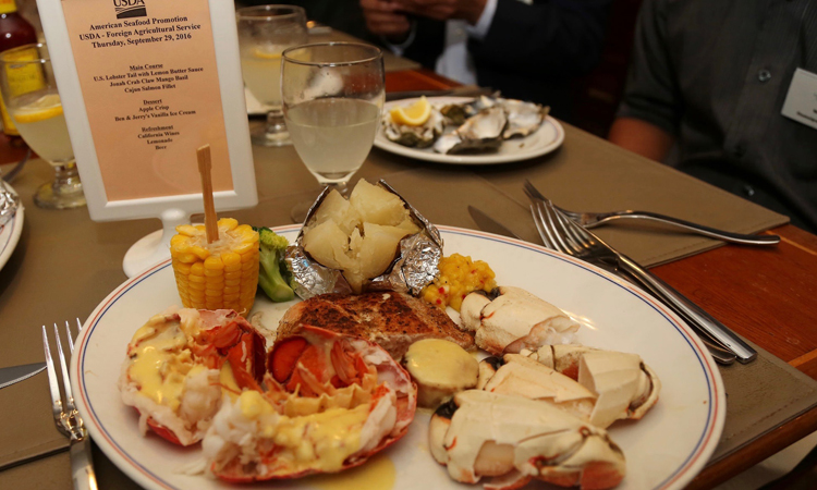 American seafood feast of lobster, Jonah crab and salmon. (U.S. Embassy photo)